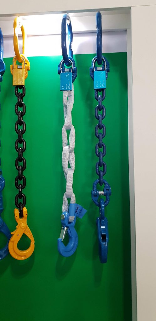 Chain and webbing slings with end attachments are some of the lifting gear on display.